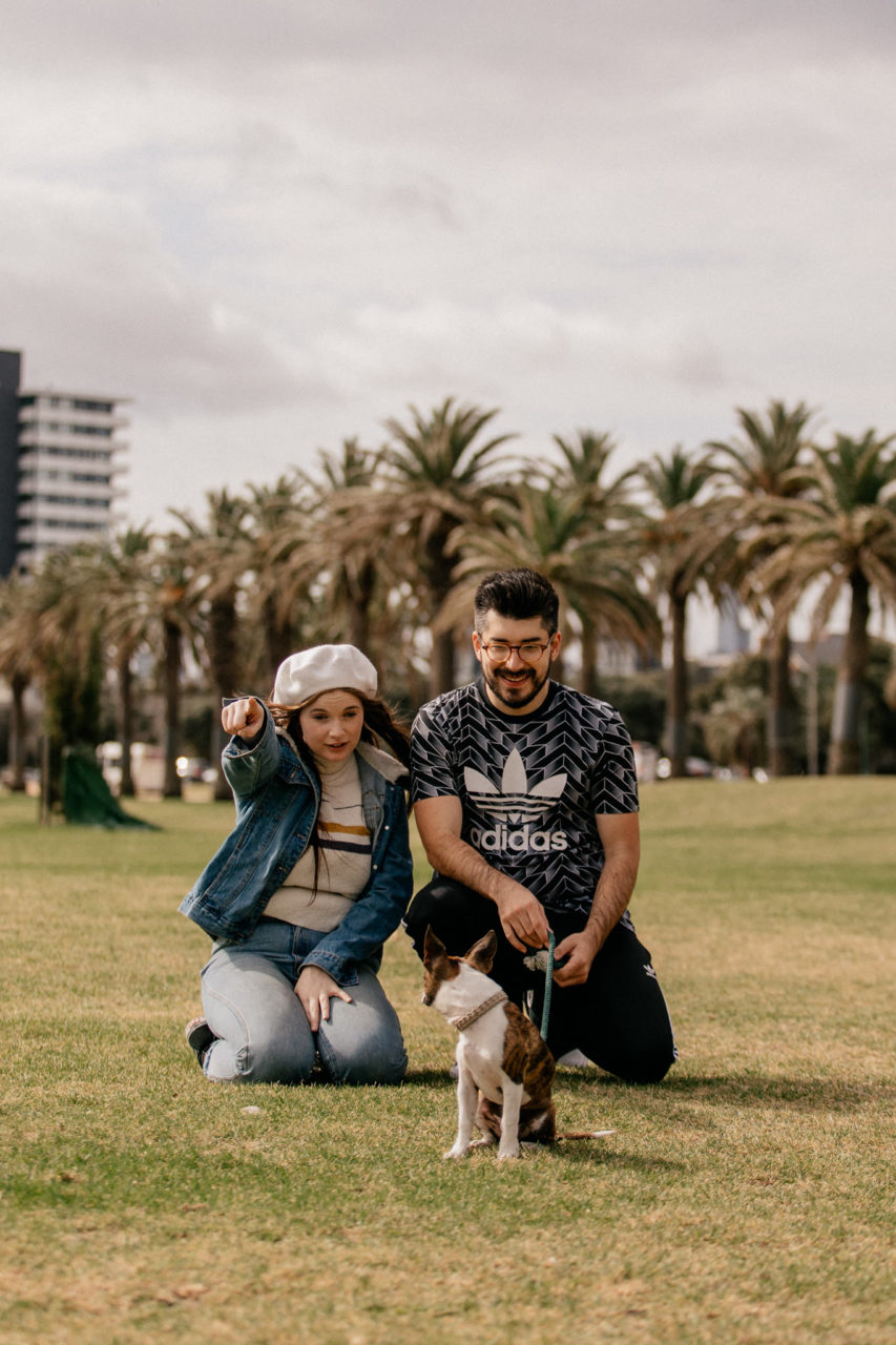 quirky st kilda photographyt-german wedding photographer melbourne-documentary candid unposed wedding photos-engagement session st klida beach-wedding with dog-chester the bochi