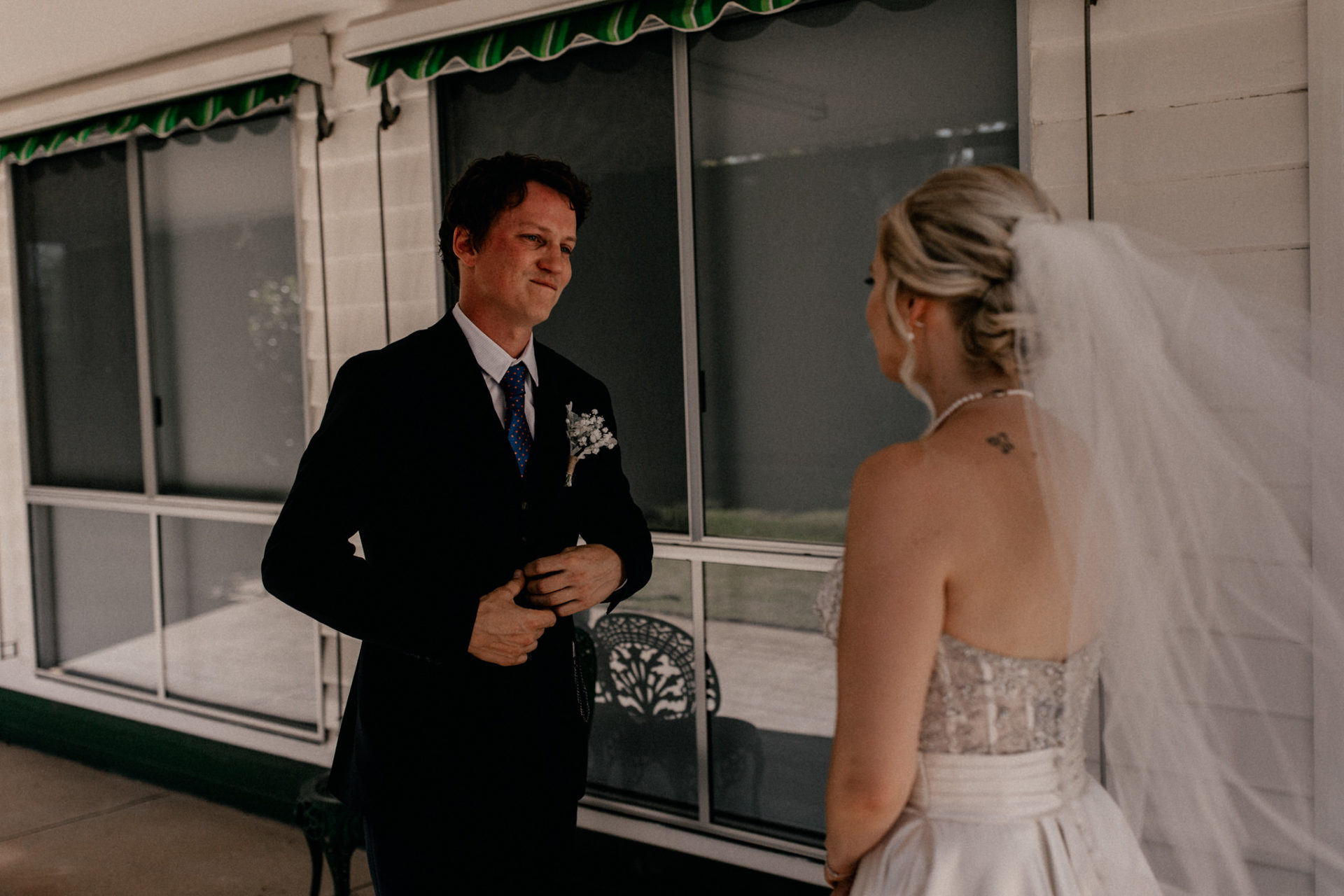 backyard-wedding-australia-melbourne-bride-groom-first-look-dancing-intimate-hug-veil-blue-suit