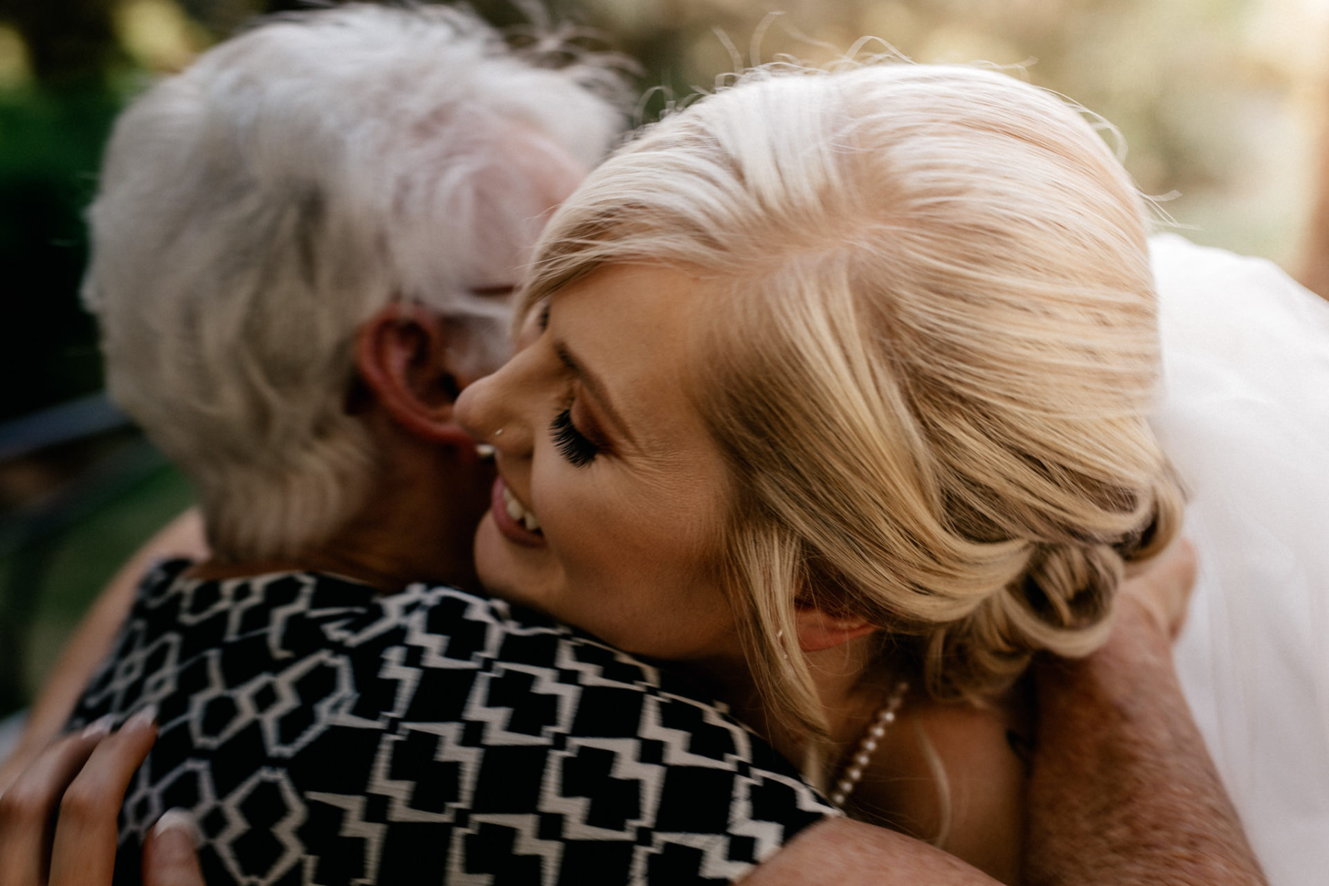 backyard-wedding-australia-melbourne-reception-hugs-grandma-congratulations-bride